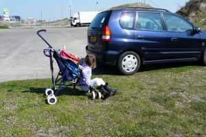 Kind in kinderwagen